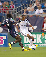 Los Angeles Galaxy forward Tristan Bowen (17) dribbles as New England Revolution defender Emmanuel Osei (5) closes. The New England Revolution defeated LA Galaxy, 2-0, at Gillette Stadium on July 10, 2010.