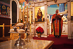 The solemn blessing of the five loaves of bread during Christmas Eve Vigil Service, St. Sava Serbian Orthodox Church, Jackson, Calif. The five loaves symbolize the loaves from the wilderness which Christ fed the masses.