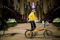 A cyclist walks through the church after attending the annual blessing of the bicycles at the Cathedral of St John the Divine in New York City, USA, 22 April 2006. Several dozens cyclists, professional and recreational, and a few roller skaters attended the ceremony  during which prayers are said for those who died in cycling accidents this year and for a safe season.