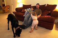 "Oct 21, 2004 - Pleasanton, CA, USA - 7:37 PM: ALEKS TWAROWSKI, 6, reads a book before bedtime to his father Joe and sister Lena, 3, in Pleasanton, Calif. The family dog Nicholas ""Felix Vavidog"" (Niko) roams in the foreground..(Credit Image: © Alan Greth)"