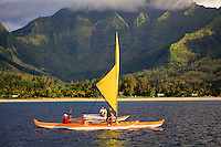 Trimaran sailing in Hanalei Bay, off the north coast of Kauai, Hawaii, USA.  No Release