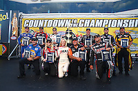 Sep 13, 2013; Charlotte, NC, USA; NHRA funny car drivers (top row L-R) Jack Beckman, Cruz Pedregon, John Force, Tim Wilkerson, Robert Hight and Del Worsham.  (bottom row L-R) Ron Capps, Courtney Force, Miss ZMax Dragway, Johnny Gray and Matt Hagan during qualifying for the Carolina Nationals at zMax Dragway. Mandatory Credit: Mark J. Rebilas-