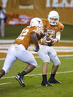 04 November 2006: Texas quarterback Colt McCoy (#12) hands off to Selvin Young (#22) during the Longhorns 36-10 victory over the Oklahoma State University Cowboys at Darrel K Royal Memorial Stadium in Austin, Texas.