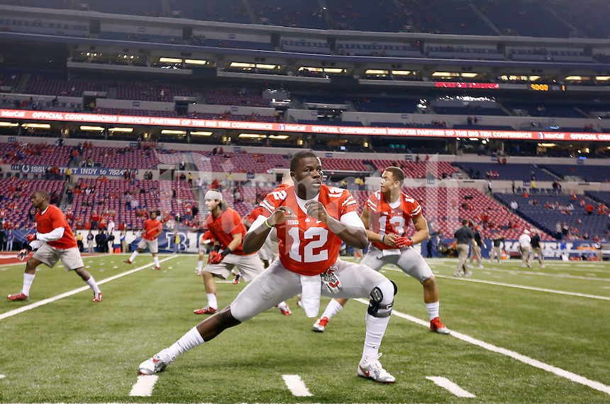Ohio State Buckeyes quarterback Cardale Jones (12) warms before their game against Wisconsin Badgers in the 2014 Big Ten Football Championship Game at Lucas Oil Stadium in Indianapolis, Ind. on December 6, 2014.  (Dispatch photo by Kyle Robertson)