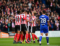 Lincoln City's Michael Bostwick, second in from right, celebrates scoring the opening goal with team-mates<br /> <br /> Photographer Chris Vaughan/CameraSport<br /> <br /> The EFL Sky Bet League Two - Lincoln City v Chesterfield - Saturday 7th October 2017 - Sincil Bank - Lincoln<br /> <br /> World Copyright &copy; 2017 CameraSport. All rights reserved. 43 Linden Ave. Countesthorpe. Leicester. England. LE8 5PG - Tel: +44 (0) 116 277 4147 - admin@camerasport.com - www.camerasport.com