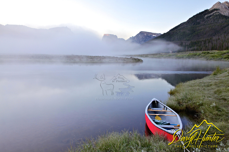 Red canoe, Green River, Wind River Mountains, Square Top Mountain, foggy morning
