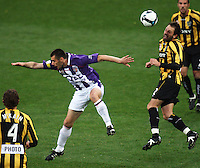 Phoenix captain Andrew Durante (right) beats Branko Jelic to a header during the A-League football match between Wellington Phoenix and Perth Glory at Westpac Stadium, Wellington, New Zealand on Sunday, 16 August 2009. Photo: Dave Lintott / lintottphoto.co.nz