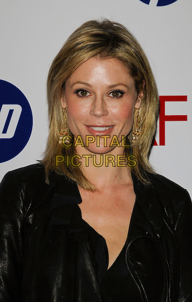 JULIE BOWEN .At the 10th Annual AFI Awards at the Four Seasons Hotel in Los Angeles, California, USA, January 15th, 2010..arrivals portrait headshot black gold dangly earrings .CAP/ROT.©Lee Roth/Capital Pictures.