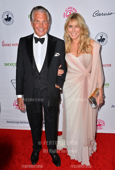 LOS ANGELES, CA. October 06, 2018: George Hamilton & Alana Stewart at the 2018 Carousel of Hope Ball at the Beverly Hilton Hotel.<br /> Picture: Paul Smith/Featureflash