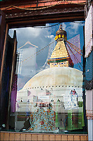 The Boudha Stupa at the Bouddhanath site reflected in a shop window. Kathmandu, Nepal.