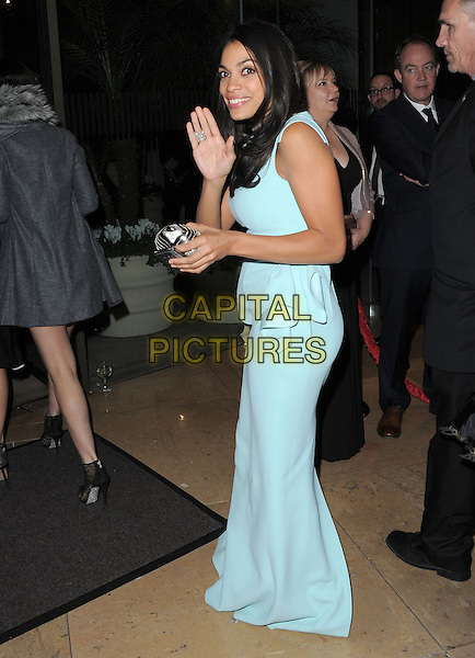 Rosario Dawson.Exiting The 70th Annual Golden Globe Awards held at The Beverly Hilton Hotel in Beverly Hills, California, USA..January 13th, 2013.globes full length blue sleeveless peplum dress side hand arm waving .CAP/DVS.©DVS/Capital Pictures.