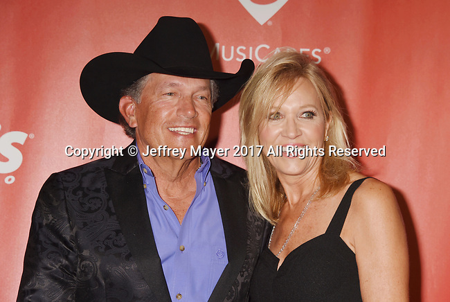 LOS ANGELES, CA - FEBRUARY 10: Singer-songwriter George Strait (L) and wife Norma Strait attend MusiCares Person of the Year honoring Tom Petty at the Los Angeles Convention Center on February 10, 2017 in Los Angeles, California.