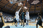 21 November 2013: North Carolina's Stephanie Mavunga (1) and Xylina McDaniel (34) fight for a rebound against Coastal Carolina's Alexx Puckett (25). The University of North Carolina Tar Heels played the Coastal Carolina University Chanticleers in an NCAA Division I women's basketball game at Carmichael Arena in Chapel Hill, North Carolina. UNC won the game 106-52.