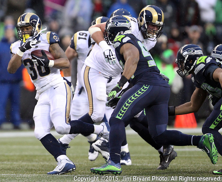 St. Louis Rams running back Todd Gurley (30) runs for a 20 yard gain against the Seattle Seahawks at CenturyLink Field in Seattle, Washington on December 27, 2015.  The Rams beat the Seahawks 23-17.      ©2015. Jim Bryant Photo. All Rights Reserved