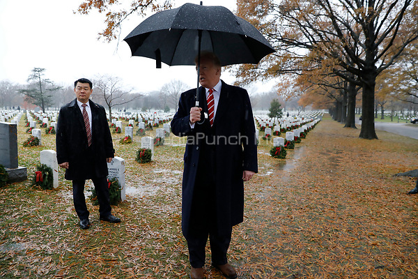 United States President Donald J. Trump speaks to reporters as he visits Section 60 at Arlington National Cemetery in Arlington, Virginia on December 15, 2018. <br /> Credit: Yuri Gripas / Pool via CNP /MediaPunch