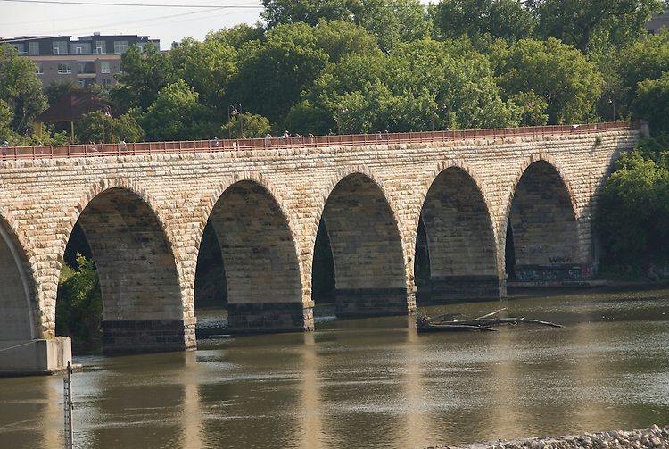 Minnesota, Twin Cities, Minneapolis-Saint Paul: Stone Arch Bridge crosses Mississippi at Minneapolis.  Former railroad bridge now used for recreation. .Photo mnqual265-75148..Photo copyright Lee Foster, www.fostertravel.com, 510-549-2202, lee@fostertravel.com.