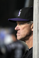 Colorado Rockies manager Jim Tracy #4 watches a game against the Los Angeles Dodgers at Dodger Stadium on July 26, 2011 in Los Angeles,California. Los Angeles defeated Colorado 3-2.(Larry Goren/Four Seam Images)