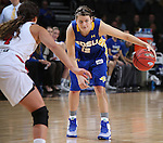SIOUX FALLS, SD - MARCH 10: Macy Miller #12 from South Dakota State University eyes the defense past Jaylah Jackson #24 from the University of South Dakota in the first half of the Summit League Championship Tournament game Tuesday at the Denny Sanford Premier Center in Sioux Falls, SD. (Photo by Dick Carlson/Inertia)