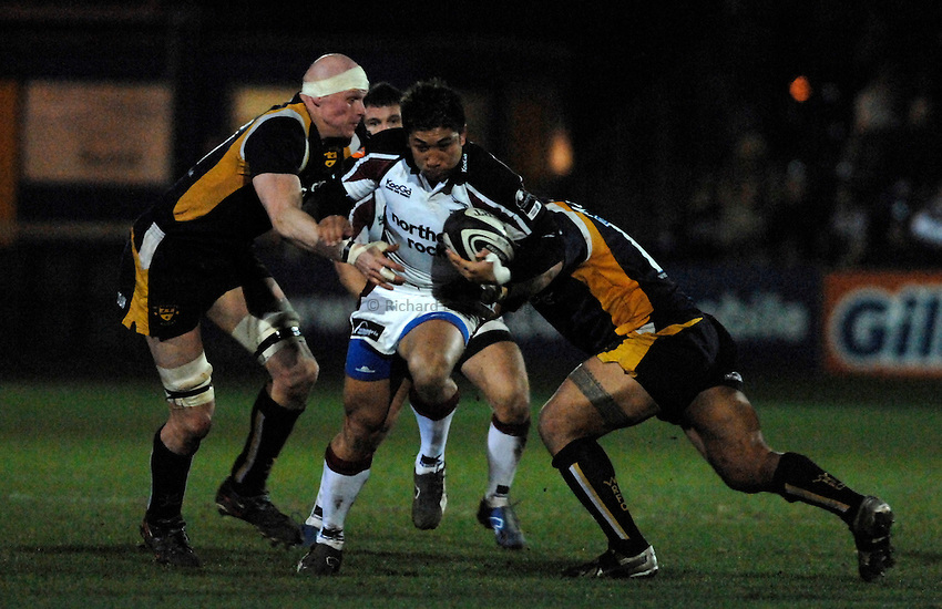 Photo: Richard Lane..Worcester Warriors v Newcastle Falcons. Guinness Premiership. 16/03/2007. .Falcon's Loki Crichton attacks as Warriors' Craig Gillies and Tevita Taumoepeau tackle.