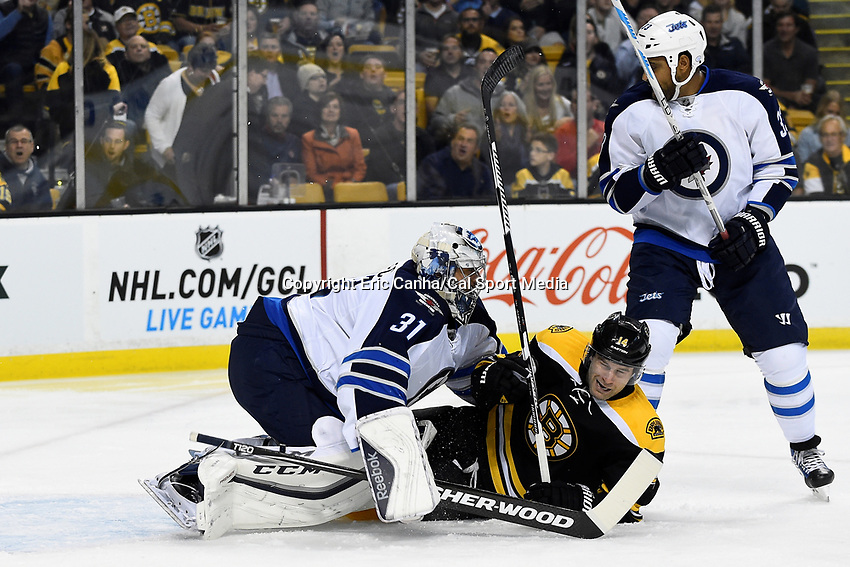 Thursday, October 8, 2015: Winnipeg Jets goalie Ondrej Pavelec (31) and Boston Bruins right wing Brett Connolly (14)  collide on the ice during the NHL game between the Winnipeg Jets and the Boston Bruins held at TD Garden, in Boston, Massachusetts. Eric Canha/CSM