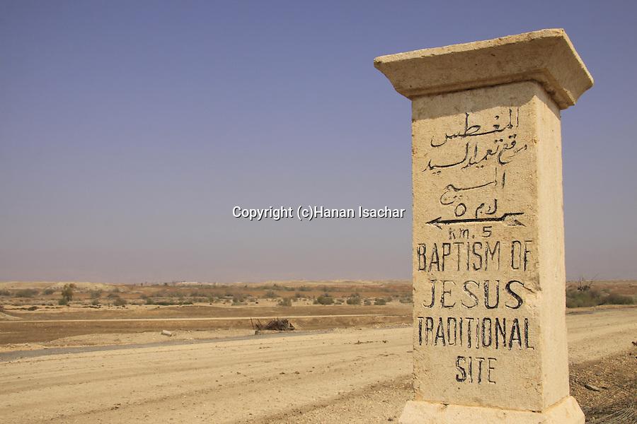Jordan Valley, a milestone on the road to Abdullah bridge poimting to Qasr al Yahud.