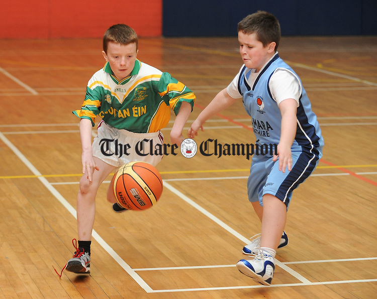 Eoin Thynne of Doora Barefield in action against Keenan Quinn of Cooraclare during their U-13 basketball game at Ennistymon. Photograph by John Kelly.