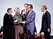 George H.W. Bush is sworn in as new director of the Central Intelligence Agency by United States Supreme Court Associate Justice Potter Stewart as Mrs Barbara Bush and U.S. President Gerald R. Ford look on at CIA headquarters in Langley, Virginia on January 30, 1976. Bush succeeds William Colby who retired. From left to right: Justice Stewart, Barbara Bush, Lieutenant General Vernon A. Walters, U.S. Army, Director Bush, and President Ford<br /> Credit: Barry Soorenko / CNP