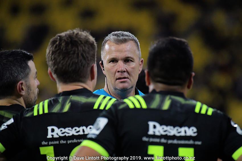 Hurricanes assistant coach Richard Watt talks to team captain Beauden Barrett during the Super Rugby match between the Hurricanes and Rebels at Westpac Stadium in Wellington, New Zealand on Saturday, 4 May 2019. Photo: Dave Lintott / lintottphoto.co.nz