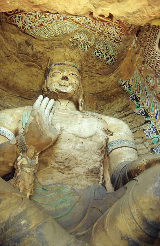 The Great Bouddha in the Yungang caves , near Datong in the Shanxi province. July, 2000.