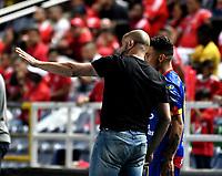 CALI - COLOMBIA, 15-09-2018: Hernán Lisi (Izq.), técnico de Deportivo Pasto, da instrucciones a Luis Carlos Arias (Der.) jugador de eportes Tolima, después de marcar gol al America, durante partido entre América de Cali y Deportivo Pasto, de la fecha 10 por la Liga Aguila II 2018 jugado en el estadio Pascual Guerrero de la ciudad de Cali. / Hernan Lisi  (L), coach of Deportivo Pasto, gives instructions to Luis Carlos Arias (R), after scoring a goal to America, during a match between America de Cali and Deportivo Pasto, of the 10th date for the Liga Aguila II 2018 at the Pascual Guerrero stadium in Cali city. Photo: VizzorImage / Luis Ramirez / Staff.