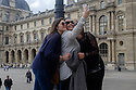Paris, France. 09.05.2015. Three women take a selfie in the courtyard of Le Louvre. Photograph © Jane Hobson.