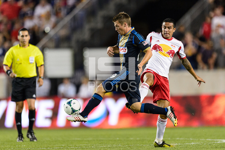 Antoine Hoppenot (29) of the Philadelphia Union plays the ball in front of Tim Cahill (17) of the New York Red Bulls. The New York Red Bulls and the Philadelphia Union played to a 0-0 tie during a Major League Soccer (MLS) match at Red Bull Arena in Harrison, NJ, on August 17, 2013.