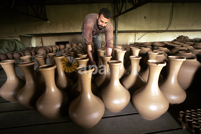 A Palestinian labourers work in a earthenware factory in Gaza City on July 1, 2009.  Palestinian merchants in Gaza are prevented from exporting to the outside because the Israeli siege on the Gaza Strip has largely been closed since June 2007 after Hamas seized control of the coastal Strip from rival Palestinian President Mahmoud Abbas. Photo By Abed Rahim Khatib