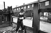 An 8 year-old boy smashes a fence for bonfire wood in a street of vandalised houses in the former pit village of Grimethorpe, South Yorkshire, which has undergone serious decline since its colliery closed in 1993, and where many ex-miners' houses are empty.