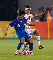 USWNT forward (6) Natasha Kai tries to take the ball away from Japanese captain (10) Homare Sawa while playing at Worker's Stadium.  The USWNT defeated Japan, 4-2, during the semi-finals of the Beijing 2008 Olympics in Beijing, China.