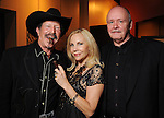"Kinky Friedman, Carolyn Farb and Ted Swindley at a reception held after a reading of ""Becoming Kinky: The World According to Kinky Friedman"" at the Stages Repertory Theater Friday Aug. 13,2010.(Dave Rossman/For the Chronicle)"