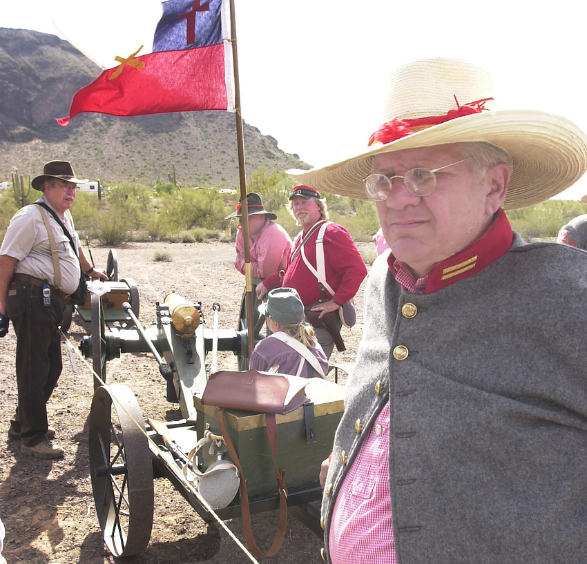 "TUCSON'S Thomas C. Ford addresses spectators during Sunday's ""Civil War in the SouthWest"" re-enactments at.Picacho Peak while holding a 12 pound cannon ball typically used by the Mountain howitzers he used Sunday during the re-enactment of the Battle of Picacho Peak, which has become known as the ""western most battle of the Civil War"". Approximately 1000 people attended Picacho Peak State Park ""The Civil War in the Southwest"" re enactments Sunday while another 1700 attended the battles on Saturday...."