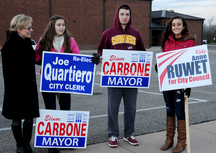 TORTINGTON, CT, 05 NOV 13- 110513AJ05- Torrington Republican mayoral candidate Elinor C. Carbone greets family members, Taylor Rogers, Landry Rogers and Carissa Carbone outside Torrington Middle School Tuesday.     Alec Johnson/ Republican-American
