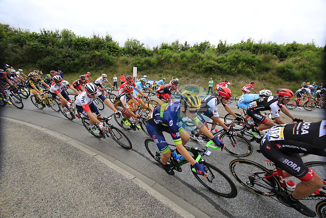 Riders including Chris Juul Jensen (IRL)(DEN) Orica GreenEdge pass through Segre during Stage 3 of the 2016 Tour de France, running 223.5km from Granville to Angers, France . 4th July 2016.<br /> Picture: Eoin Clarke | Newsfile<br /> <br /> <br /> All photos usage must carry mandatory copyright credit (&copy; Newsfile | Eoin Clarke)