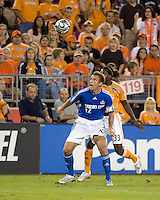 Kansas City Wizards defender Jimmy Conrad (12) shields the ball from Houston Dynamo forward Joseph Ngwenya (33). The Houston Dynamo defeated the Kansas City Wizards 2-0 at Robertson Stadium in Houston, TX on November 10, 2007 to capture the MLS Western Conference Championship. The Houston Dynamo will take on the New England Revolution in the MLS Cup Final on November 18, 2007 at RFK Stadium in Washington D.C.