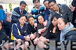 Some of the Chinese community.in Kerry holding a vigil in the.Square, Tralee, on Monday night.