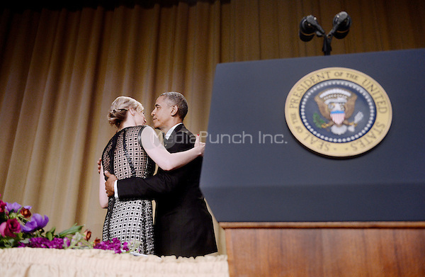 United States President Barack Obama gives a hug to  White House Correspondents' Association President Carol Lee during the annual dinner on April 30, 2016 at the Washington Hilton hotel in Washington.This is President Obama's eighth and final White House Correspondents' Association dinner.<br /> Credit: Olivier Douliery / Pool via CNP/MediaPunch