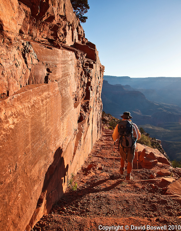 A hiker hiking rim-to-rim on the South Kaibab Trail in the Grands Canyon, Arizona.