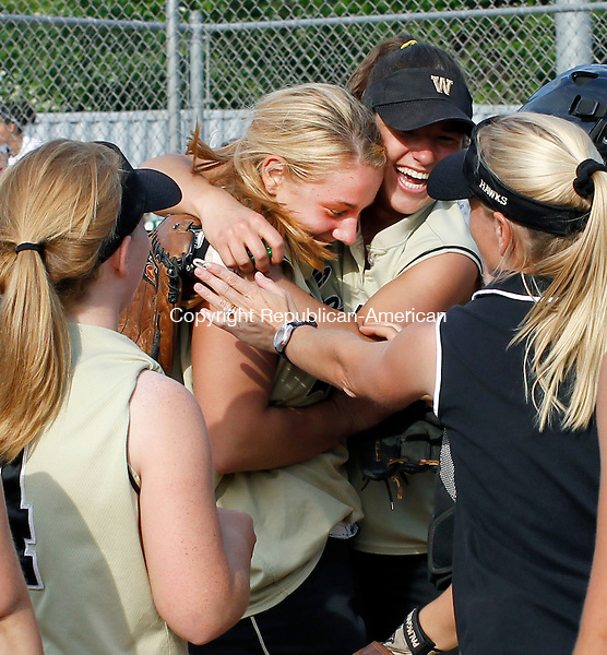 Naugatuck, CT-27, May 2010-052710CM10  Woodland's Katie Alfiere gets swarmed by teammates, Thursday afternoon at Naugatuck High School.  Alfiere lead Woodland to a 4-2 NVL Championship against Seymour.  --Christopher Massa Republican-American