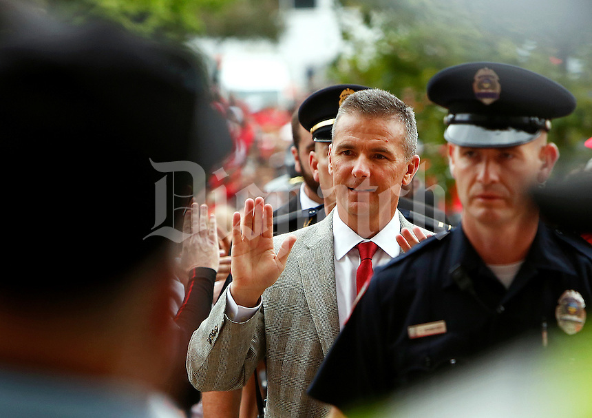Ohio State head coach Urban Meyer enters Ohio Stadium before taking on Kent State in Columbus, Saturday morning, September 13, 2014. (Dispatch Photo by Jenna Watson)
