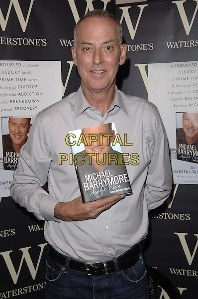 "MICHAEL BARRYMORE .signing copies of his book ""Awight Now"" at Waterstone's, Bluewater shopping centre, West Thurrock, Essex, .England, UK, 3rd October 2006..half length grey gray shirt .CAP/FIN.©Steve Finn/Capital Pictures."