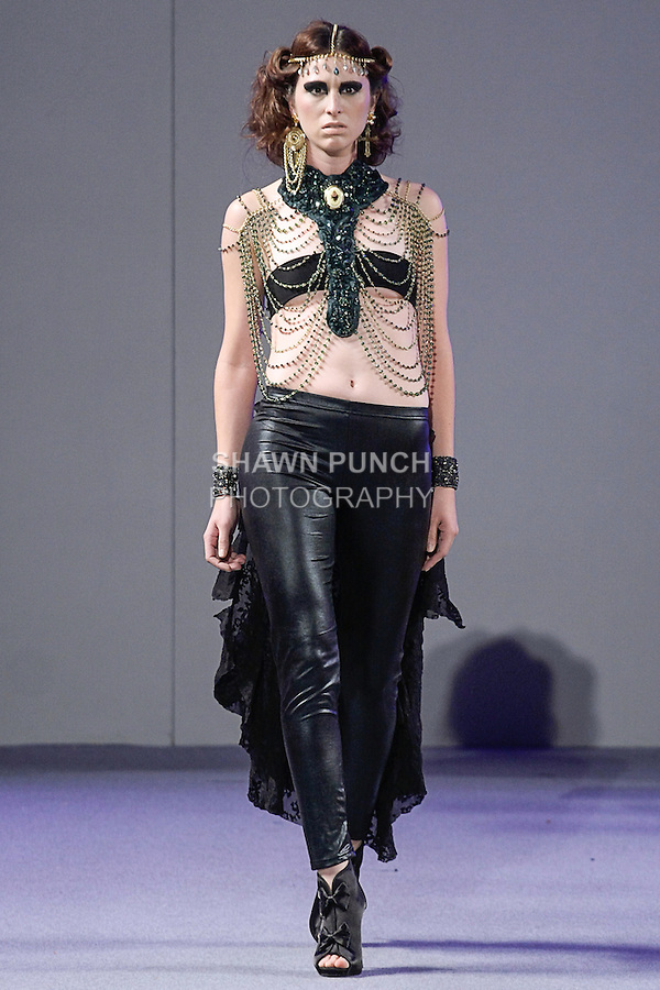 """Model walks runway in an outfit from the Wendy Luzon Spring Summer 2013 """"Until the End"""" collection, during Couture Fashion Week in New York City, September 15, 2012."""