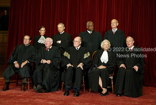 The justices of the United States Supreme Court gather for a group portrait at the Supreme Court Building in Washington, DC on  December 5, 2003.  Traditionally, the justices pose for a group portrait only when there is a change.  The court has not changed in nine years.  Left to right in front row are: Associate Justice Antonin Scalia; Associate Justice John Paul Stevens;  Chief Justice of the United States William Hubbs Rehnquist;  Associate Justice Sandra Day O'Connor;  and Associate Justice Anthony M. Kennedy. Back row, from left are: Associate Justice Ruth Bader Ginsburg;  Associate Justice David Hackett Souter;  Associate Justice Clarence Thomas;  and Associate Justice Stephen Breyer.