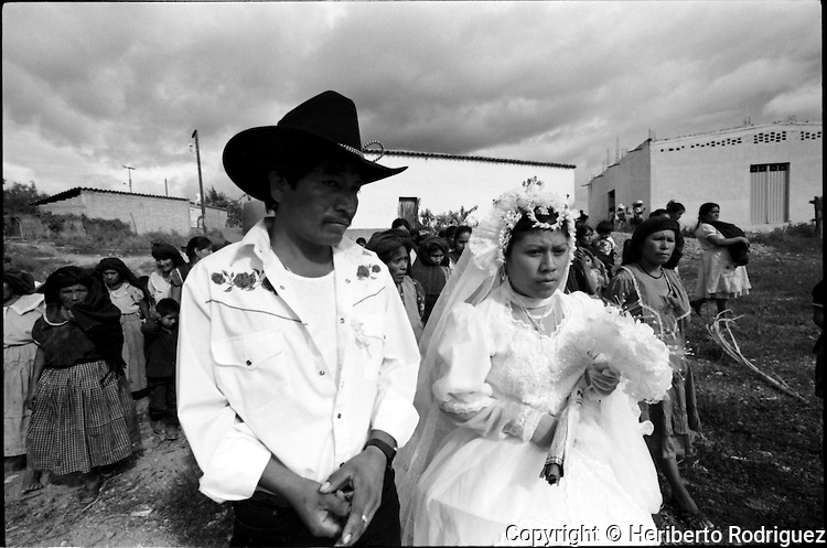 A Zapotec Native newly-married couple arrives at their house in Coatecas Altas village, Oaxaca, November 22, 1998. Most of the villagers of Coatecas leave their home to harvest in northern state of Sinaloa.  © Photo by Heriberto Rodriguez