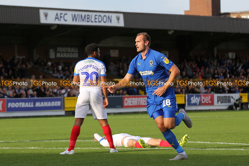 James Hanson celebrates scoring AFC Wimbledon's opening goal during AFC Wimbledon vs Portsmouth, Sky Bet EFL League 1 Football at the Cherry Red Records Stadium on 13th October 2018